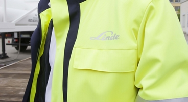 HiQ safety concept - Linde safety coat with gas truck as background - landscape