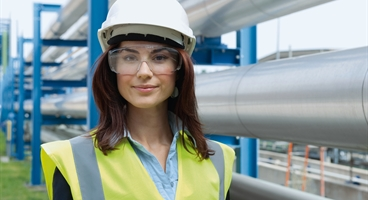 Ladie wearing PPE working at a chemical plant